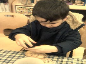 boy making cookies