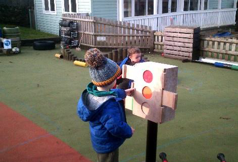 child looking at traffic lights