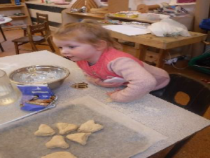 child making heart shapes in dough