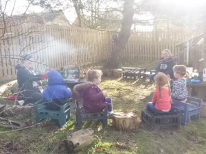 children sitting on logs