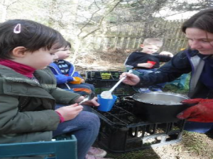 serving porridge at forest school