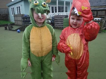 boys in red and green dragon costumes