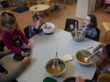 children with bowls of cake mixture