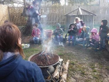 children observing campfire