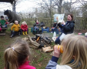children listening to goldilocks by campfire