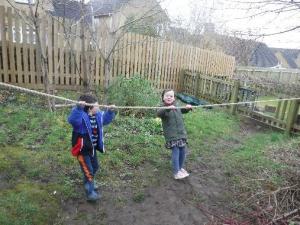 children walking holding rope