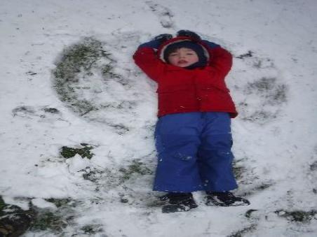 child lying in snow