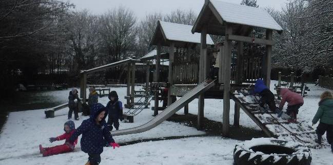 children playing in snowy garden
